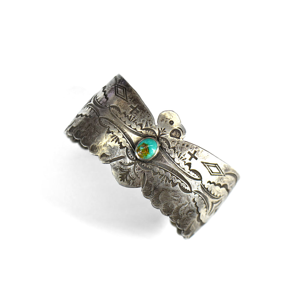 engraved silver bracelet with large eagle design and turquoise stone set in the centre