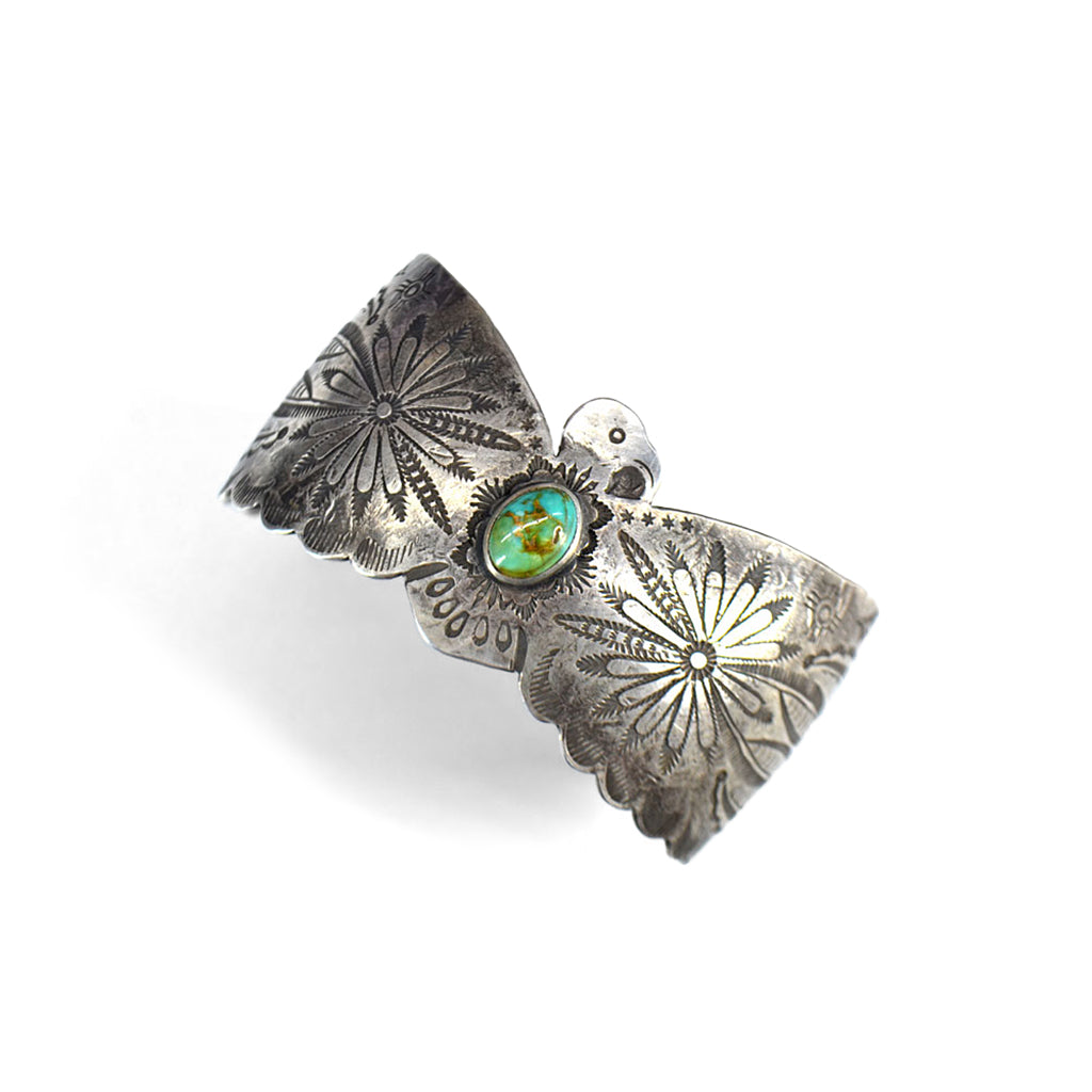 Silver engraved bracelet in shape of eagle with green turquoise stone in the centre