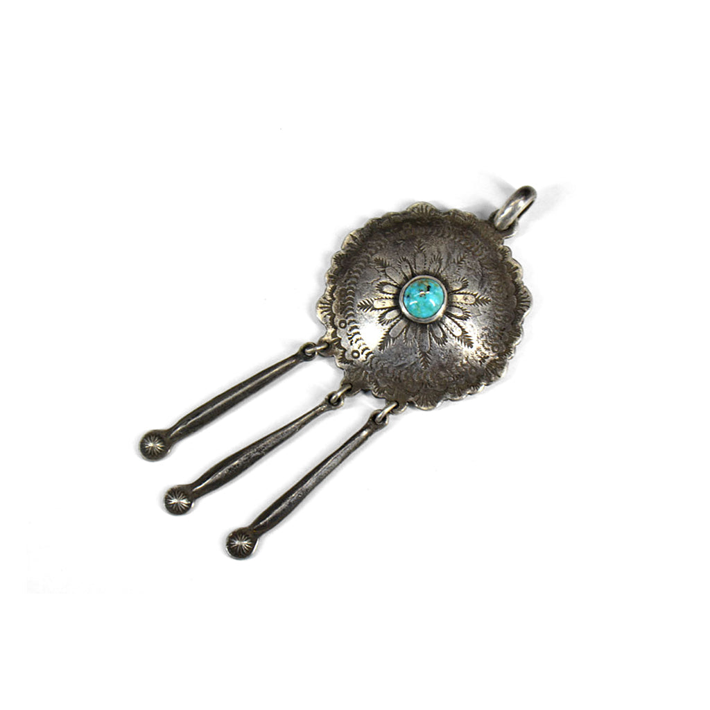 engraved silver round pendant with three hanging spoked and a blue turquoise stone central to the disc