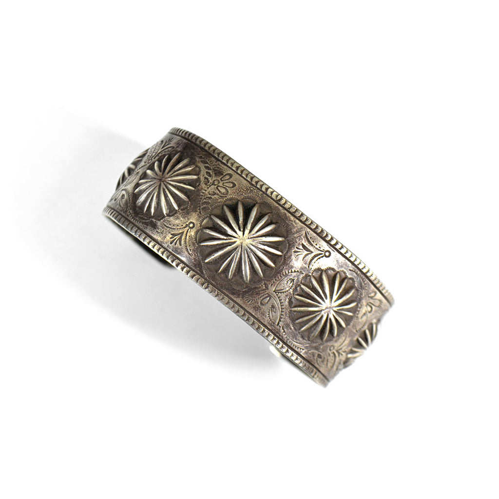 Engraved silver bracelet with star design and bevelled edges