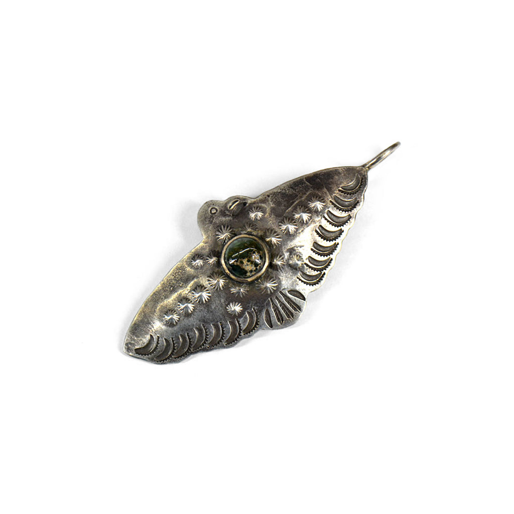 Thunderbird profile silver pendant with dark green precious stone in the centre