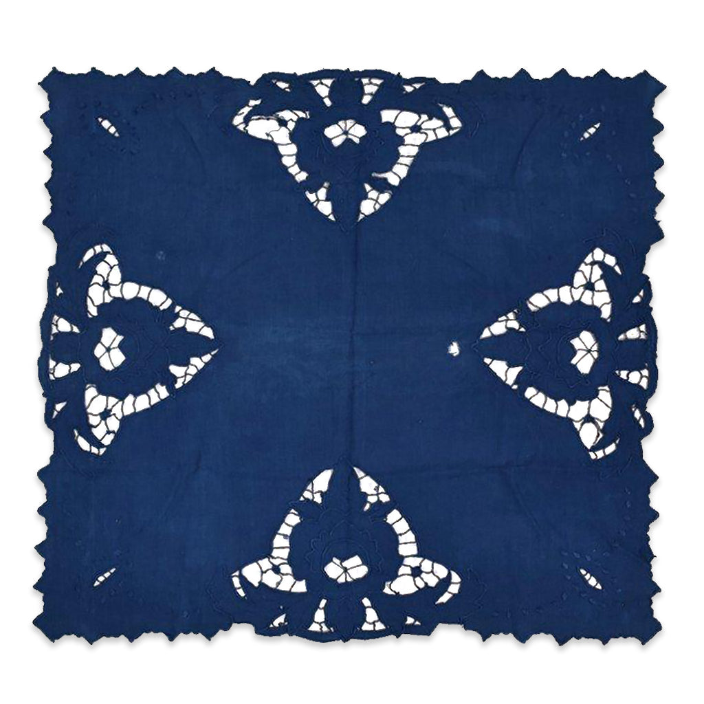 Indigo over dyed vintage French linen table runner with beautiful cut outs in the material creating wonderful geometric pattern. The runner also has scalloped edging that matches the intricate fabric cut out design.