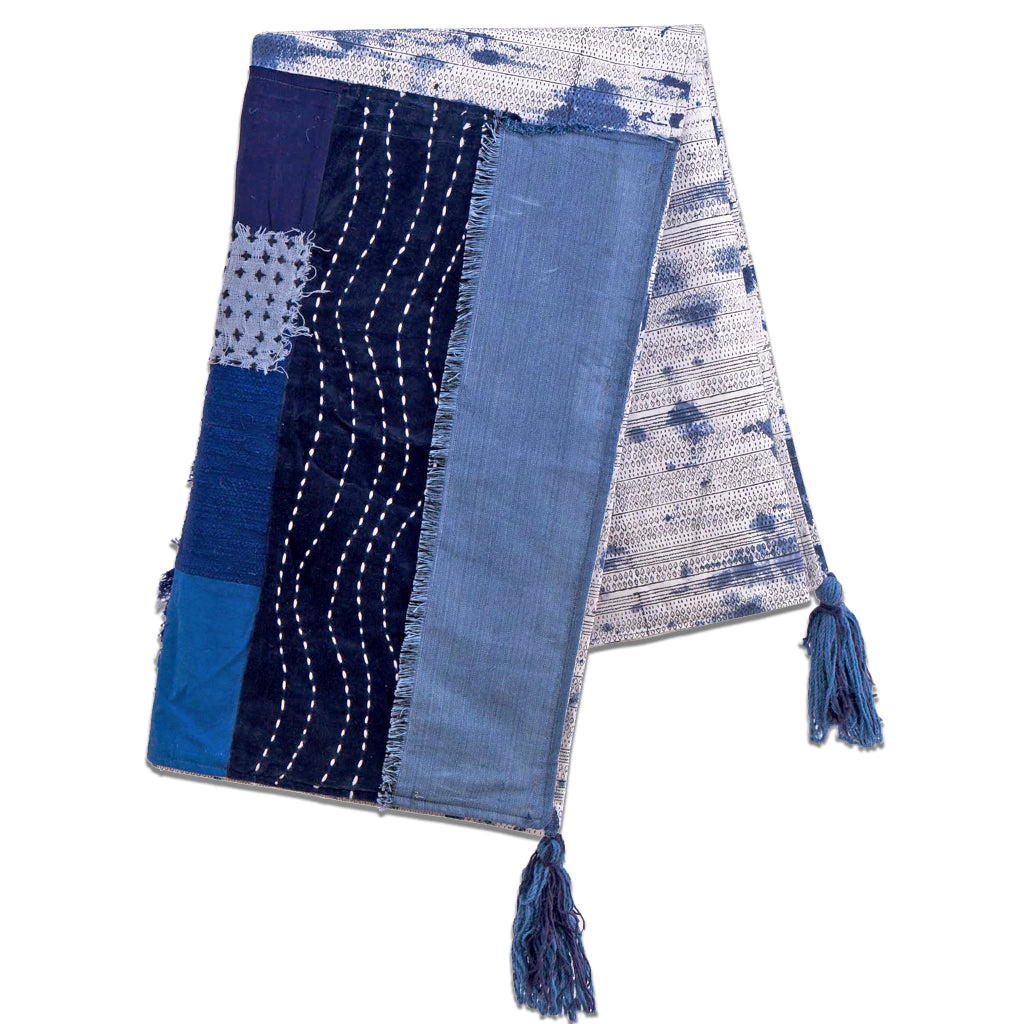 Throw in varying shades of indigo with blue tassled corners