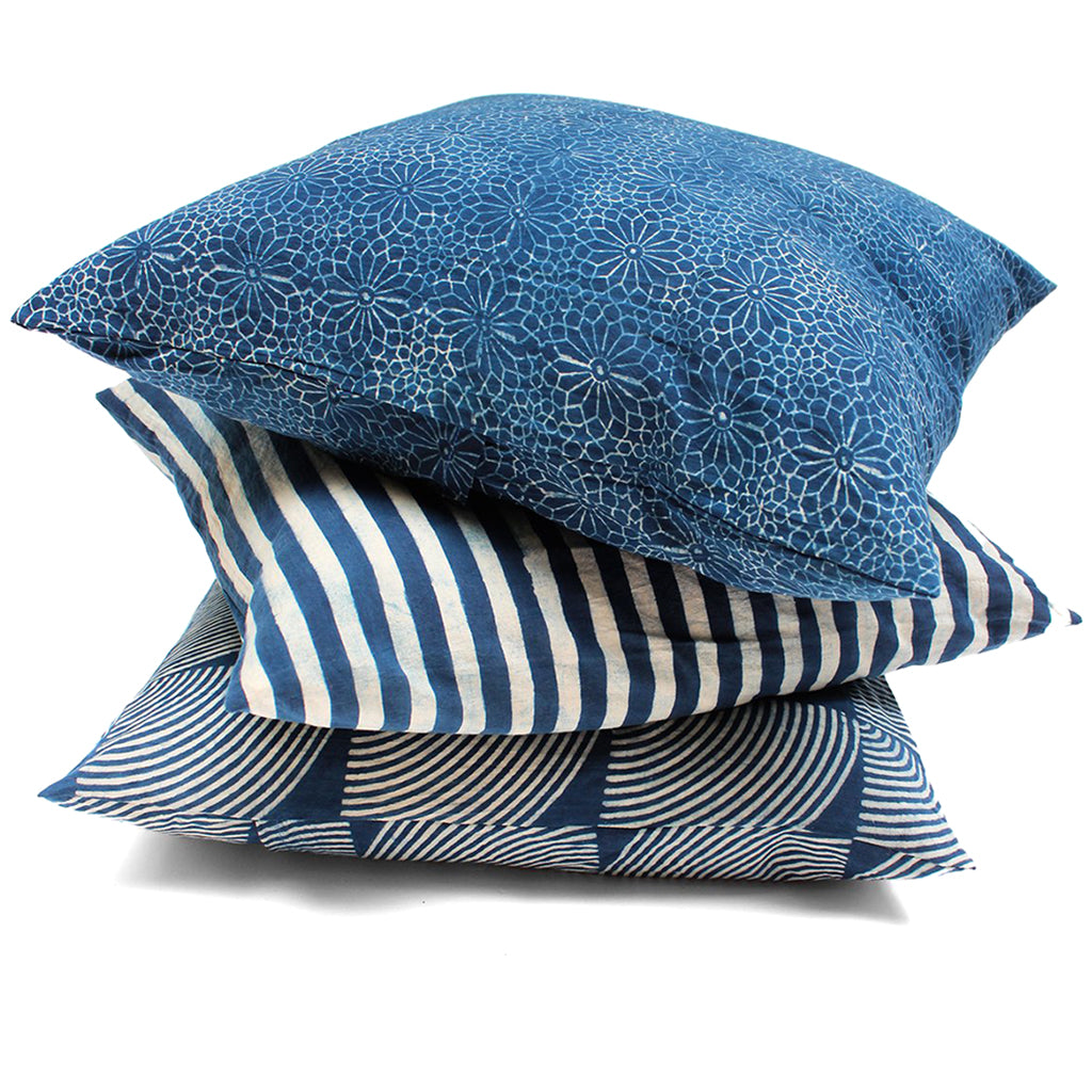 Set of three indigo dyed pillows.
