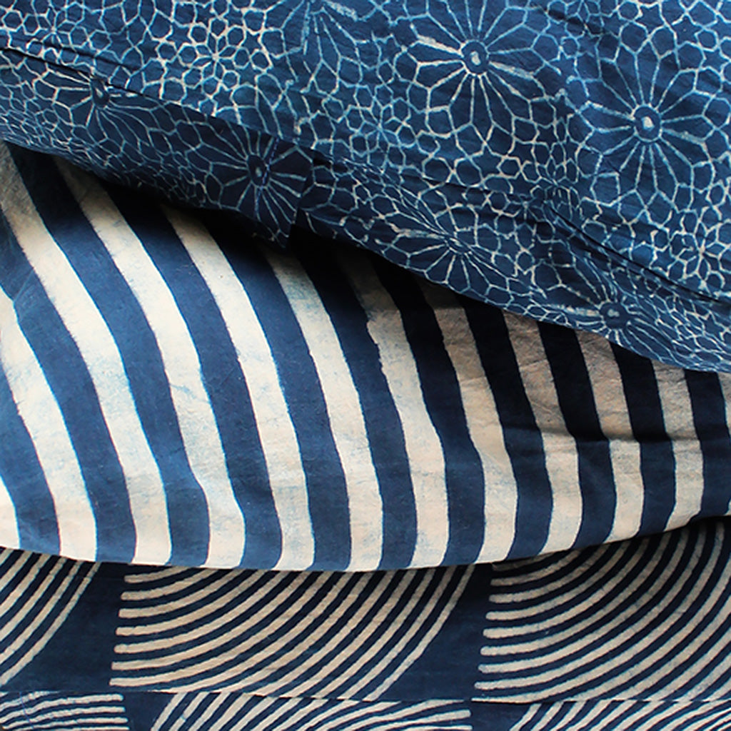 Detail of three indigo dyed pillows.