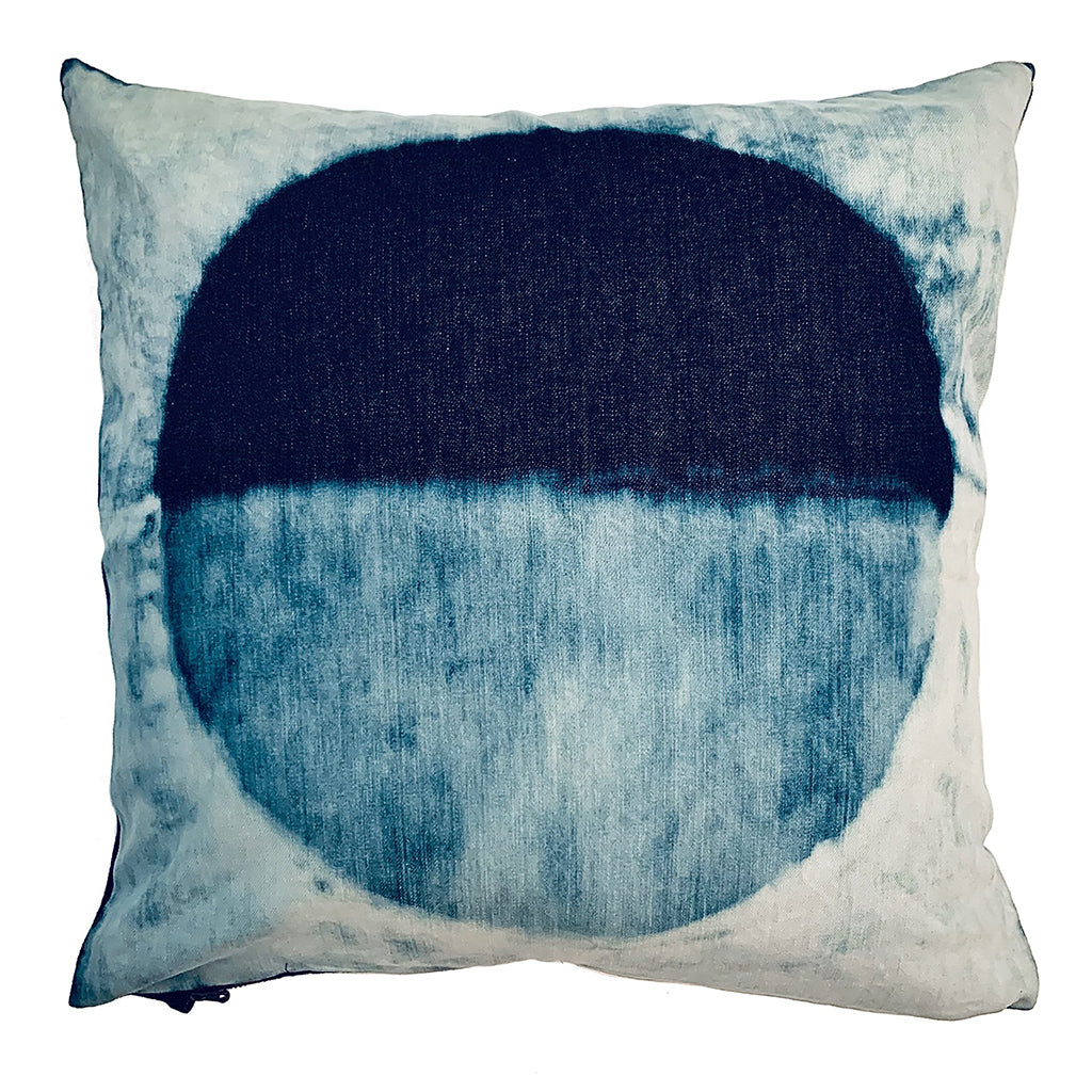 Decorative white throw pillow with indigo full moon shape on the front