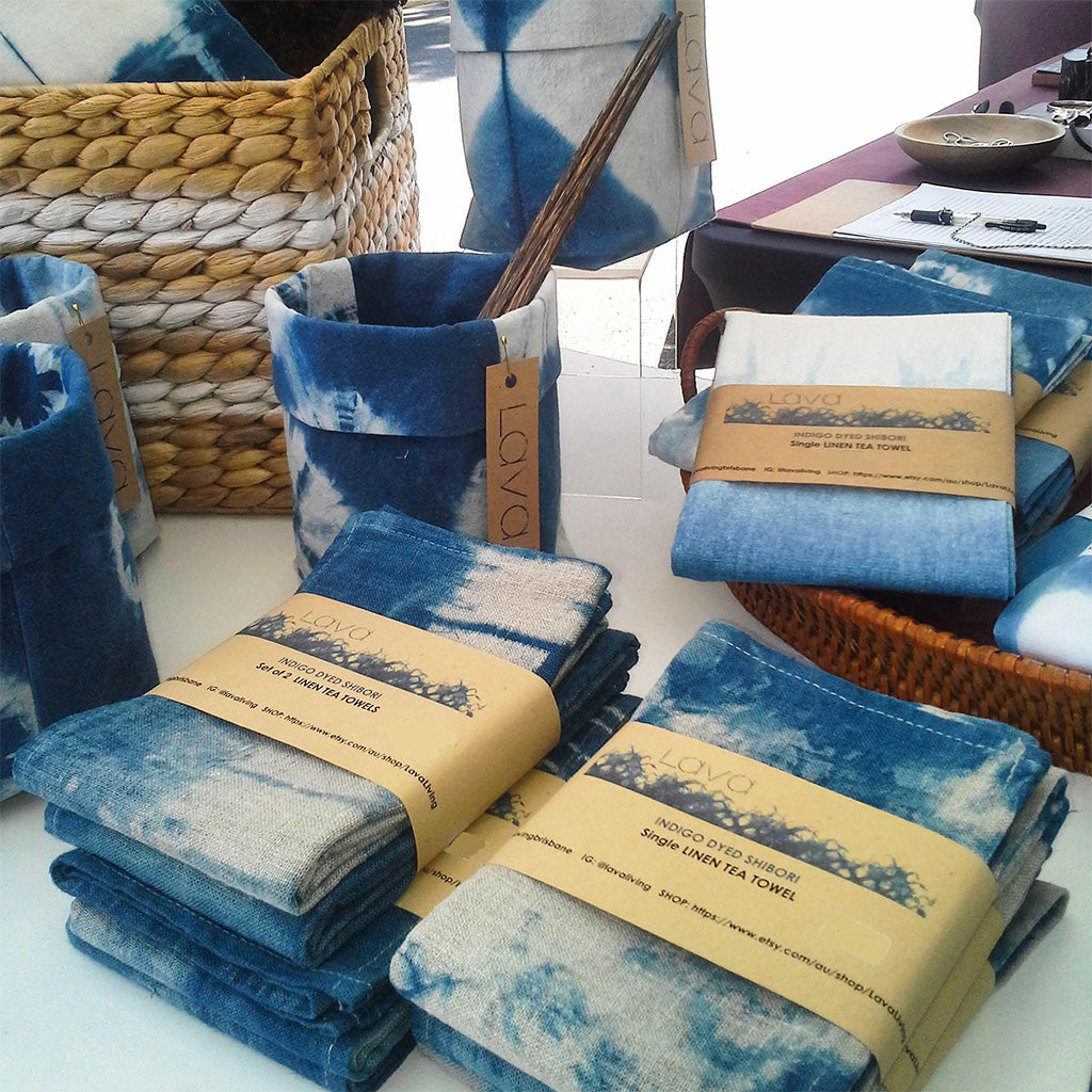 Shibori Linen Tea Towels folded on a table in packs