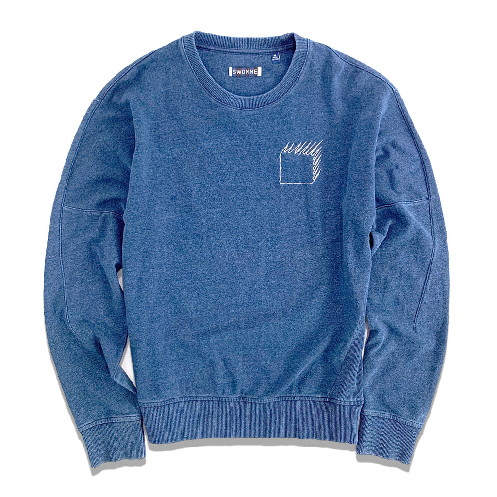 Indigo blue Sweatshirt by Swonne. Ribbed bottom and cuffs, with crew neck and logo on top left pocket of an embroidered square with shadow.