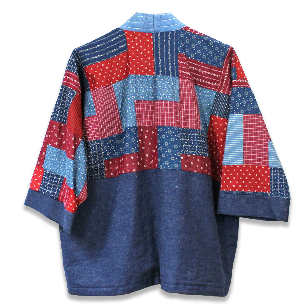 back view of patchwork quilt jacket in shades of blue and red using recycled denim and vintage quilts.