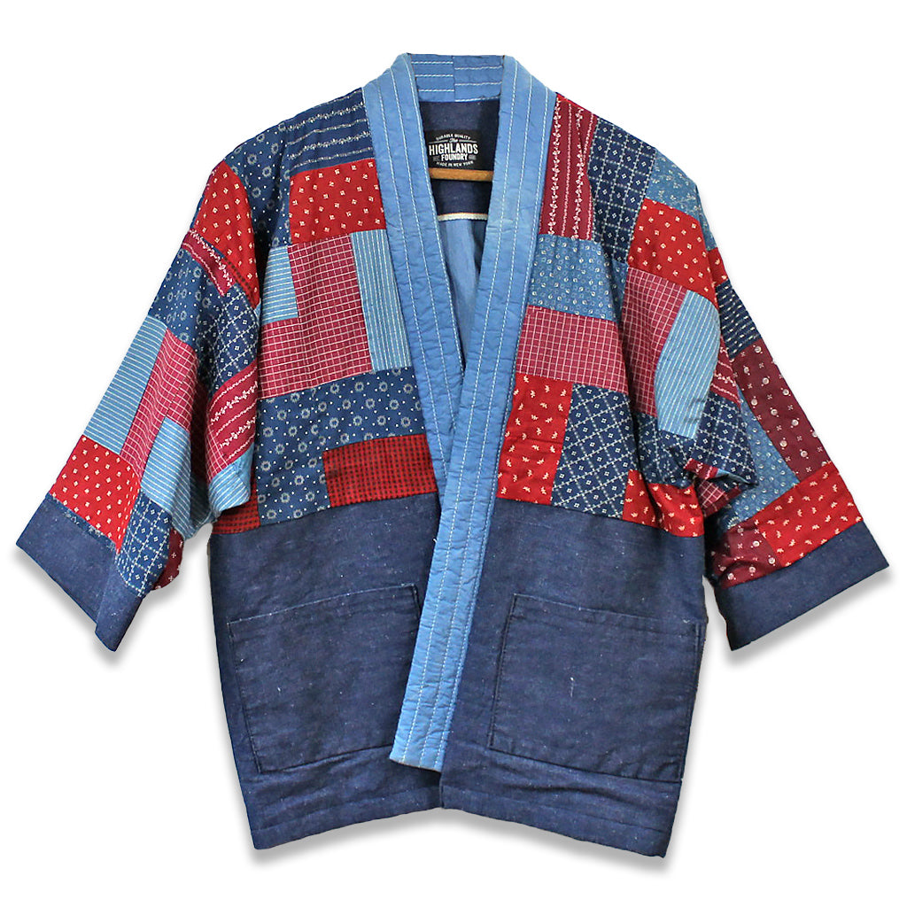 Patchwork quilt jacket in shades of blue and red using recycled denim and vintage quilts.