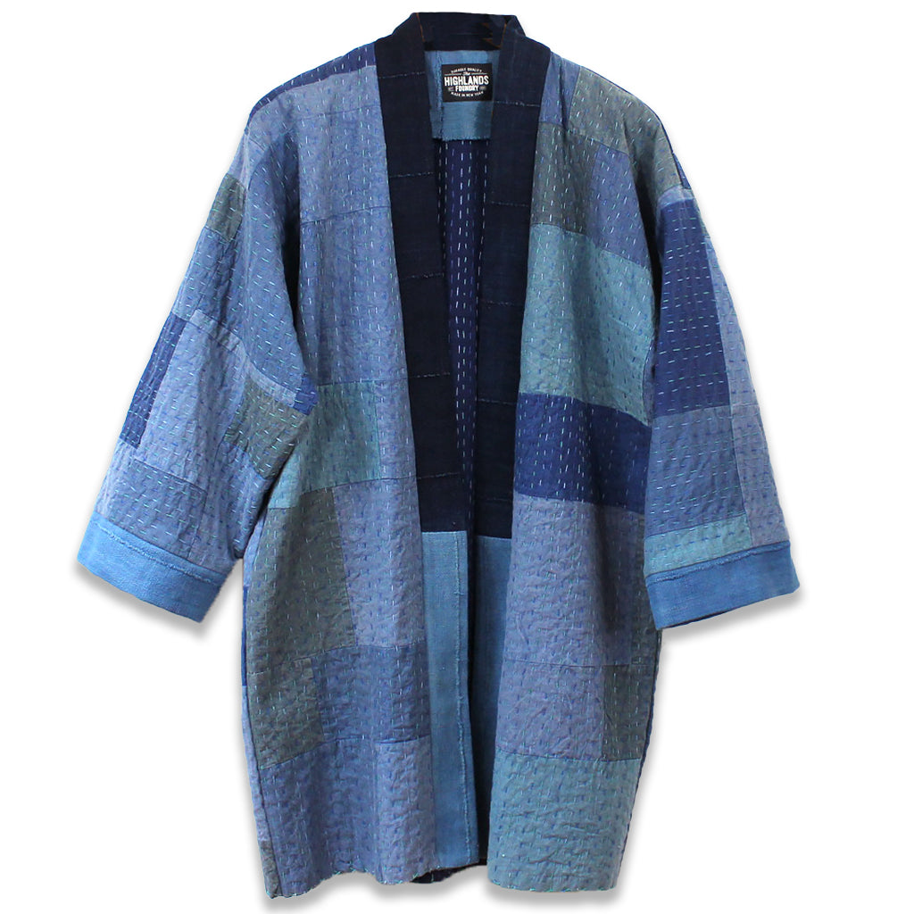 Patchwork indigo and blue kantha quilt jacket made from recycled materials.