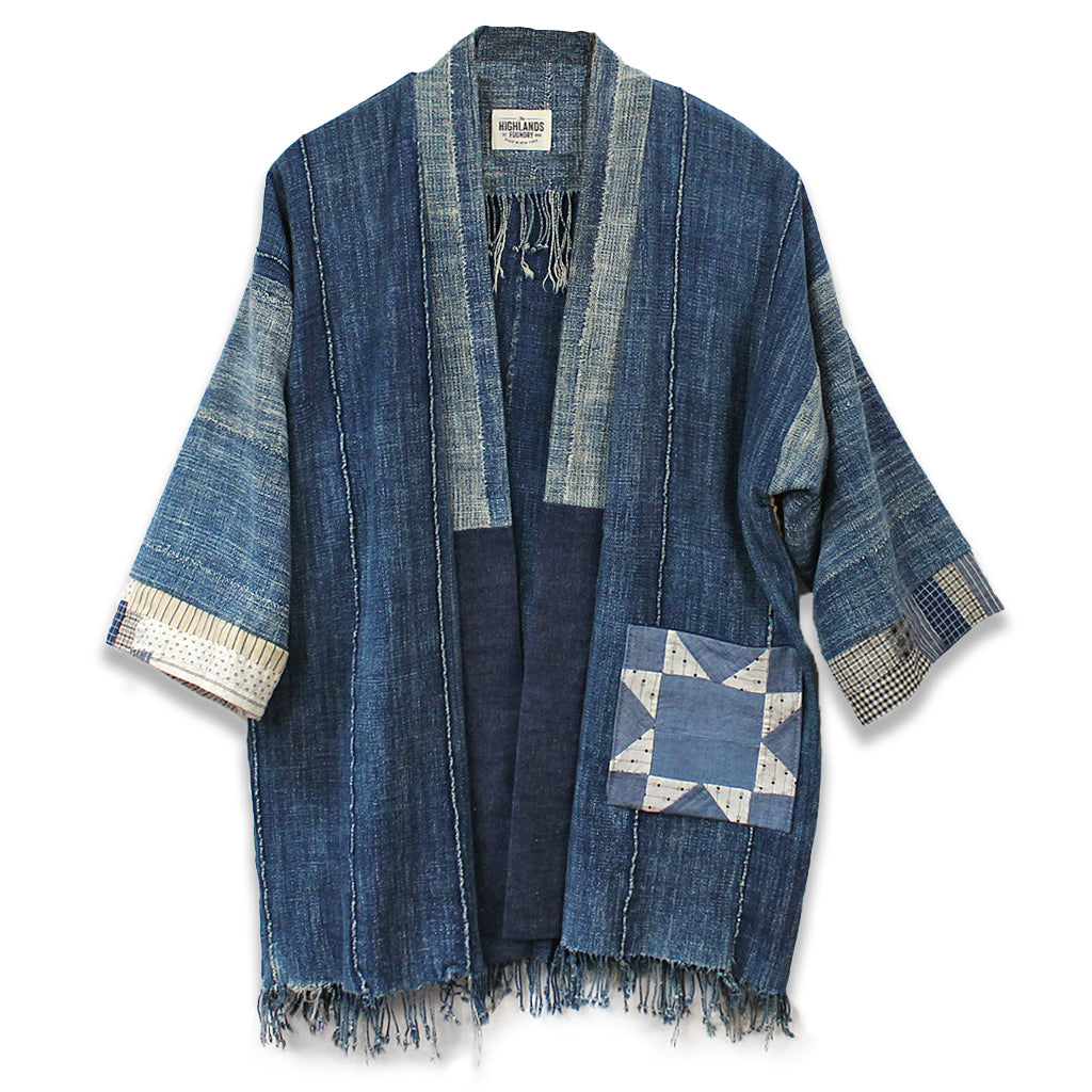 Indigo jacket made using cloth from Burkina Faso, West Africa featuring star antique patchwork piece on the front pocket.
