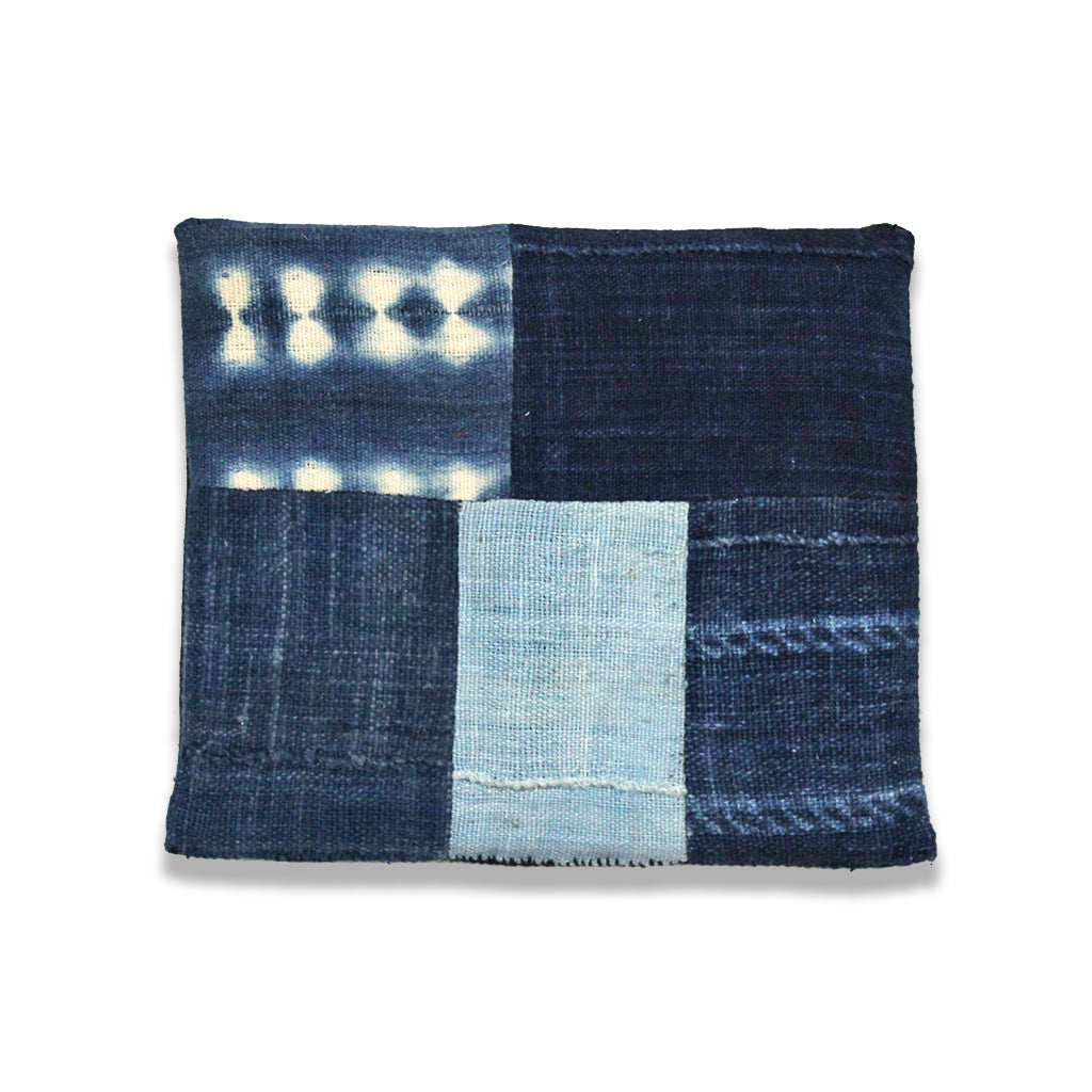 Patchwork trivet made from solid indigo and Shibori cloth.