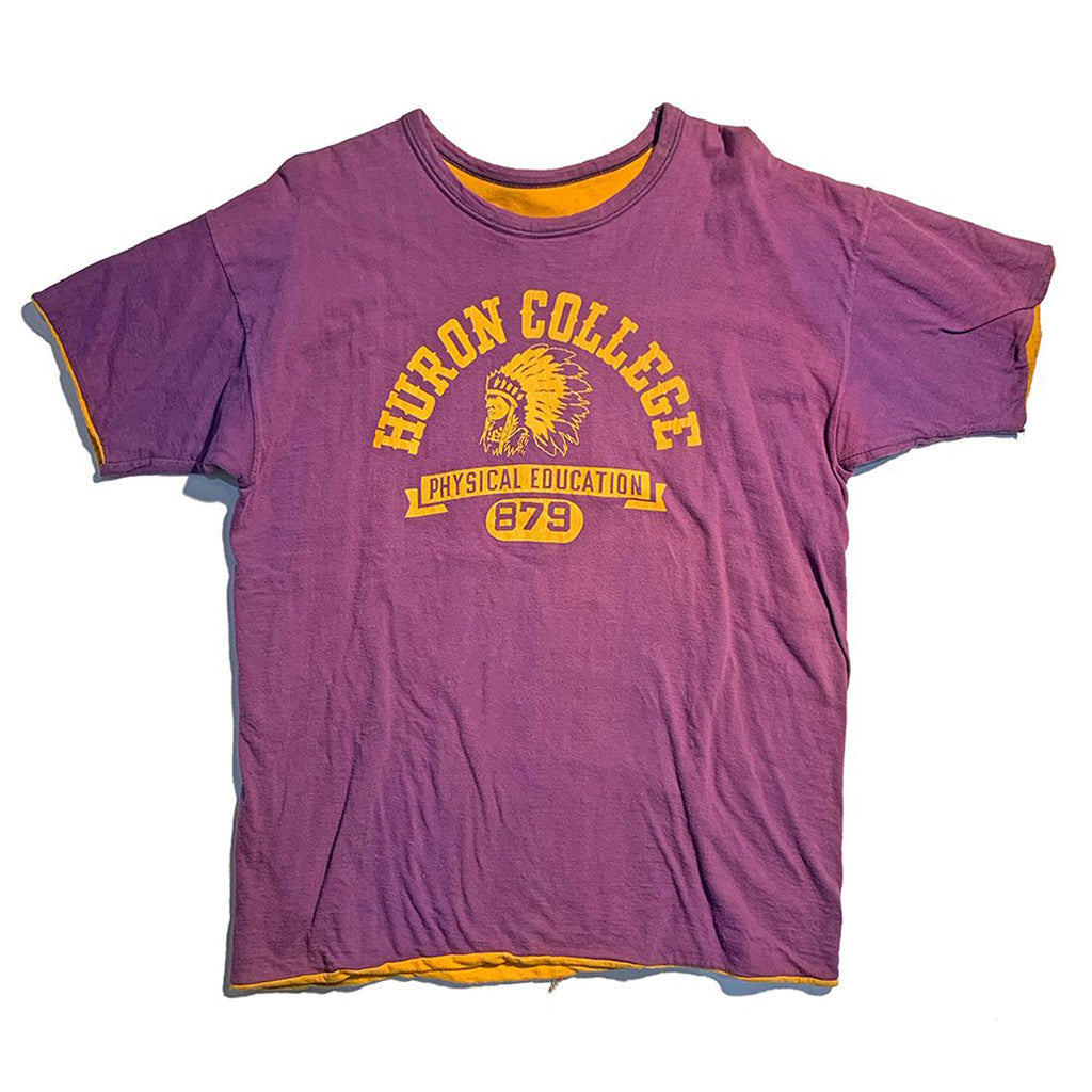 1950s Huron College reversible T-shirt made by Champion. Reverses to plain yellow.