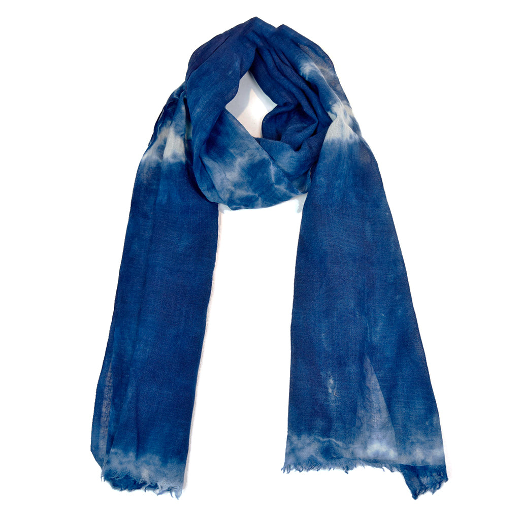 Indigo dyed hand woven scarf using both 100% natural indigo and 100% wool. Dyed by hand using a traditional Japanese shibori technique, the scarf is beautifully soft and light weight