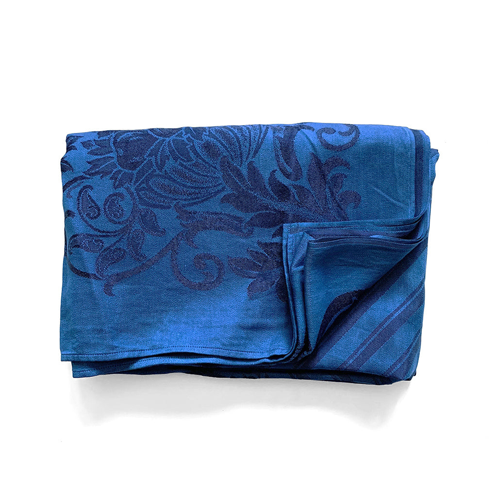 Natural Indigo Over Dyed Table Cloth with darker indigo abstract pattern by Indiko shown folded.