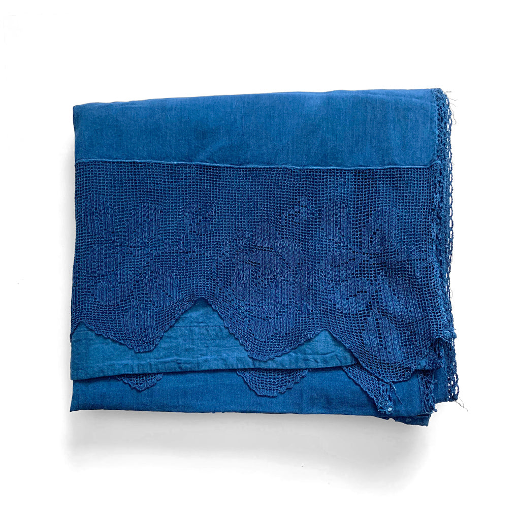 Indigo over dyed vintage linen curtain with drawn thread embroidery lace insertions by indiko shown folded