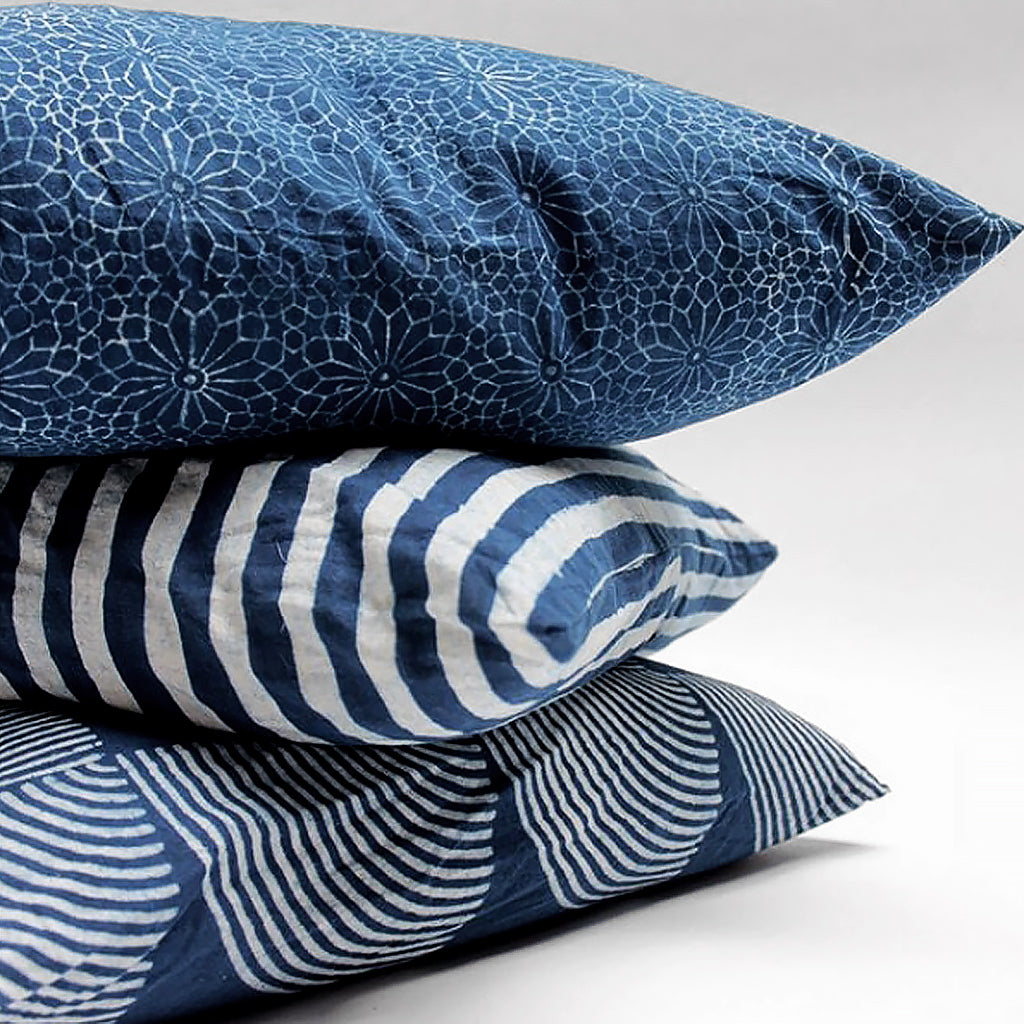 Three stacked indigo dyed pillows