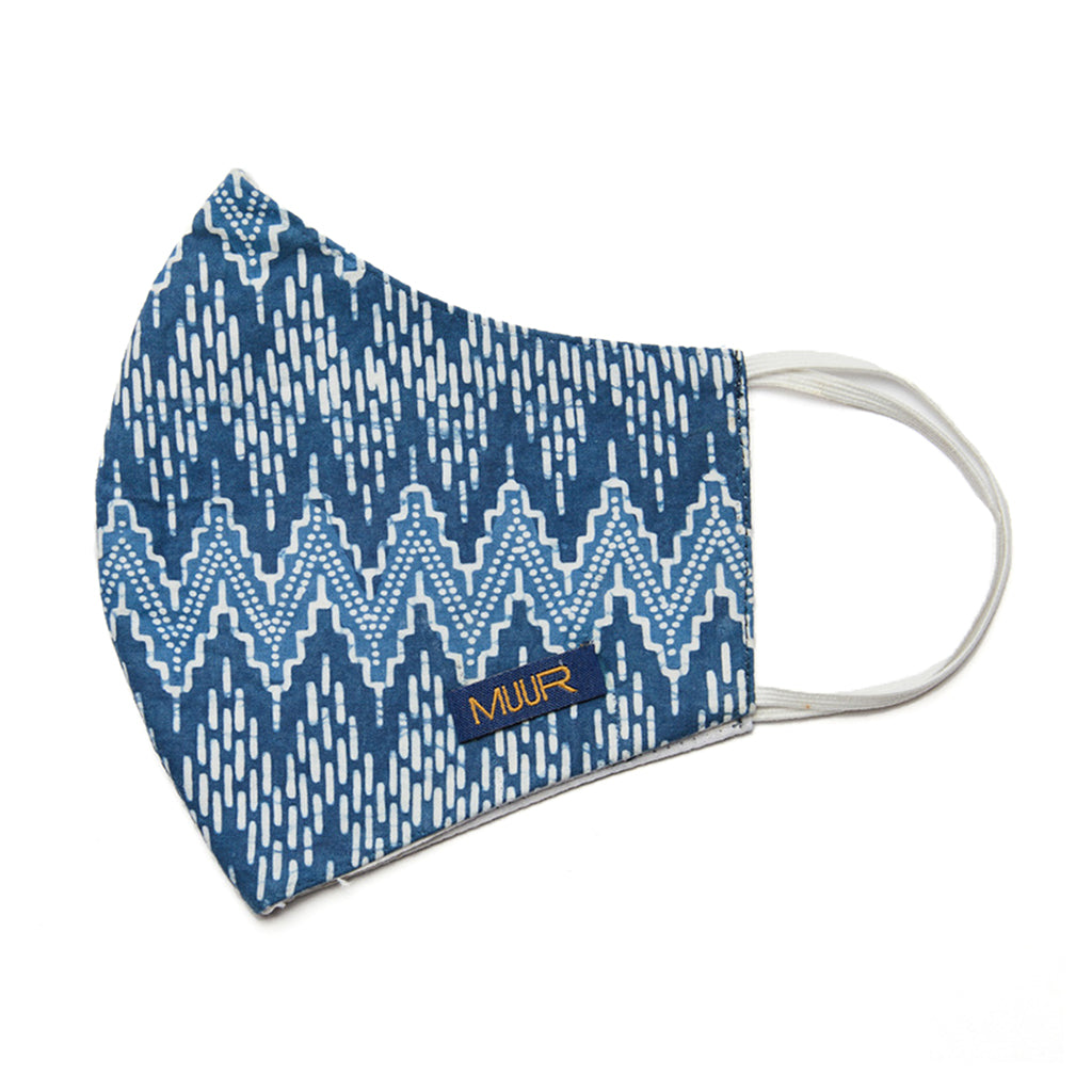 handcrafted batik dyed in a chevron indigo design facemask by Muur