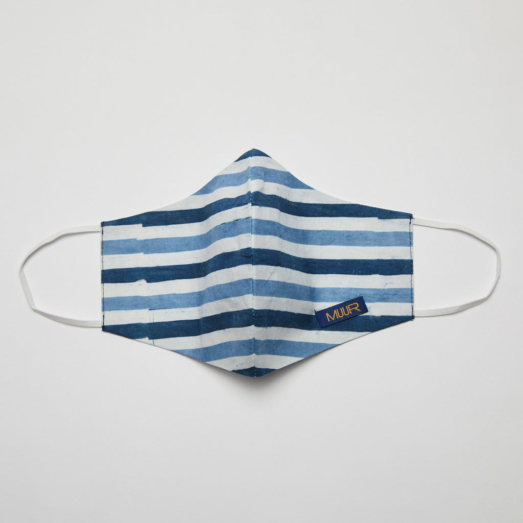 handcrafted batik dyed facemask by Muur in an indigo and white striped design