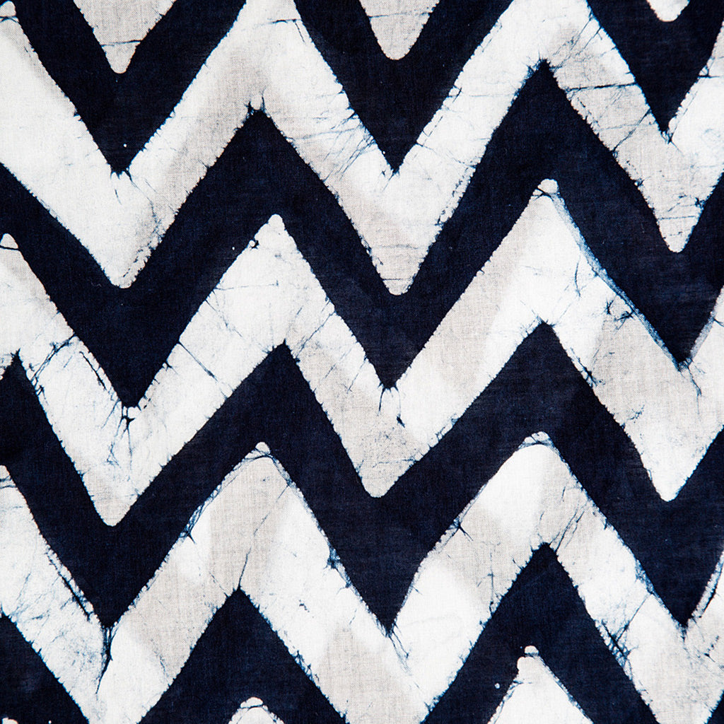 Close up of indigo and white chevron hand printed scarf with stitched edging by Muur