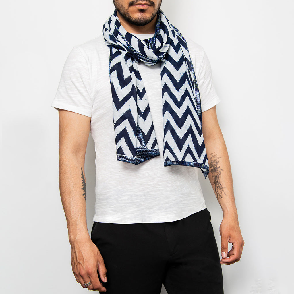 indigo and white chevron hand printed scarf with stitched edging shown around a mans neck