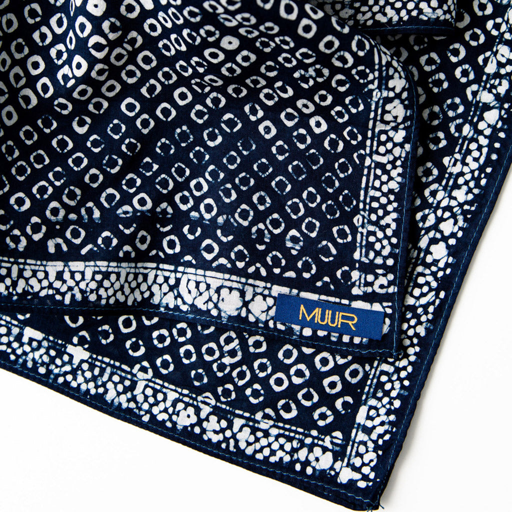 Corner and Muur logo label on Hand painted indigo dyed bandana in dot indigo and white print with darker stitched edging by Muur