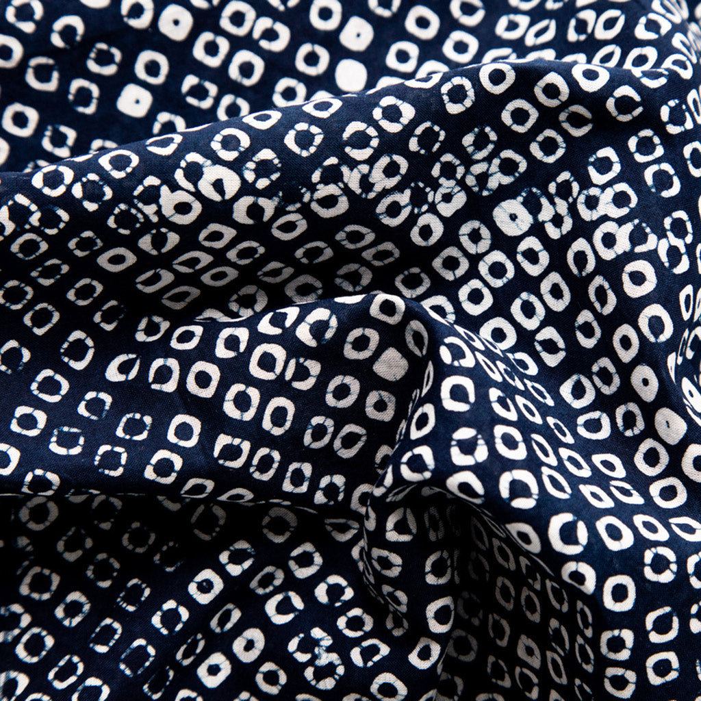 Close up of Hand painted indigo dyed bandana in dot indigo and white print  by Muur