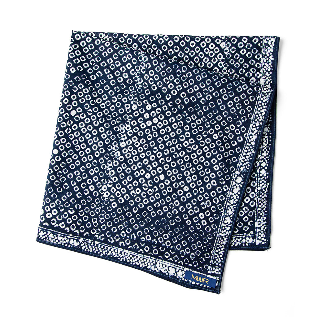 Folded Hand painted indigo dyed bandana in dot indigo and white print with darker edging by Muur