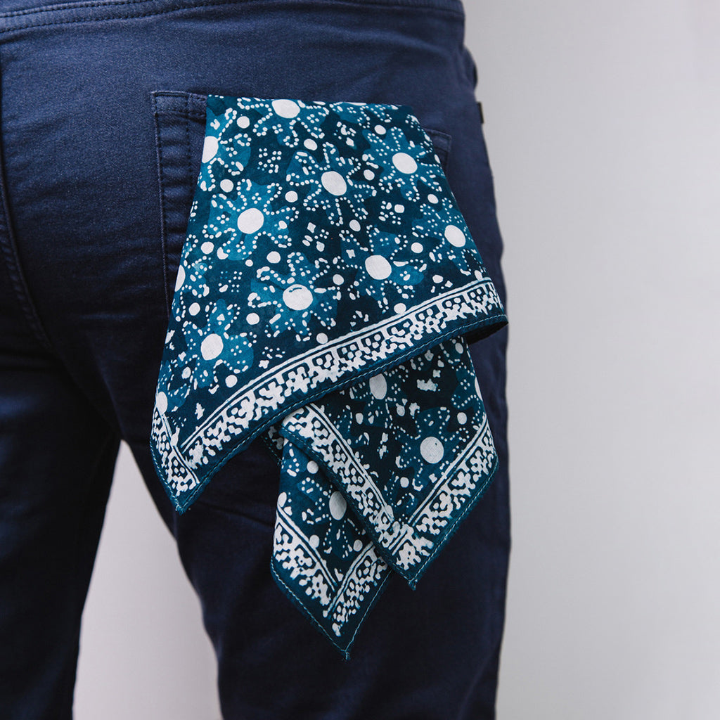 Indigo Dyed and Hand Painted Floral Bandana by Muur shown in back pocket of mans jeans
