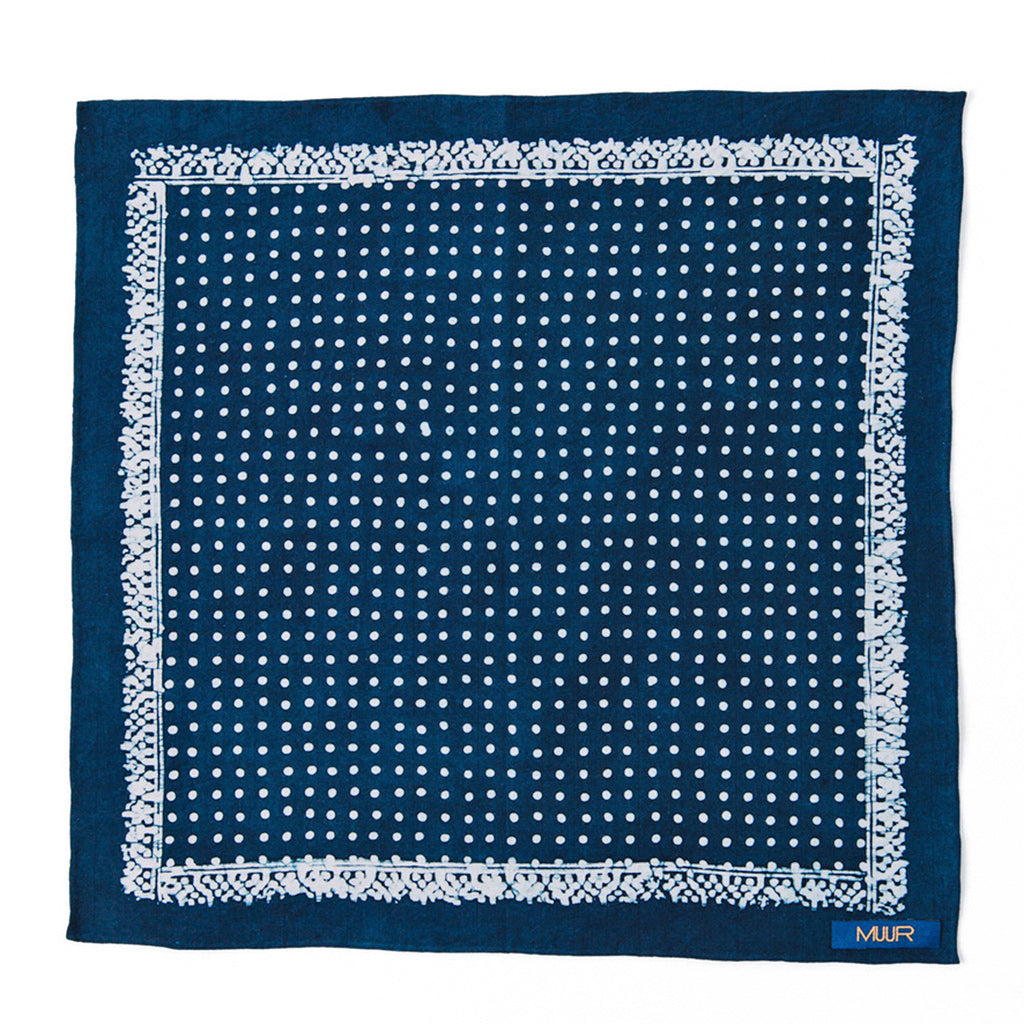 Hand painted pocket square dyed with indigo in a dot symmetrical pattern by Muur