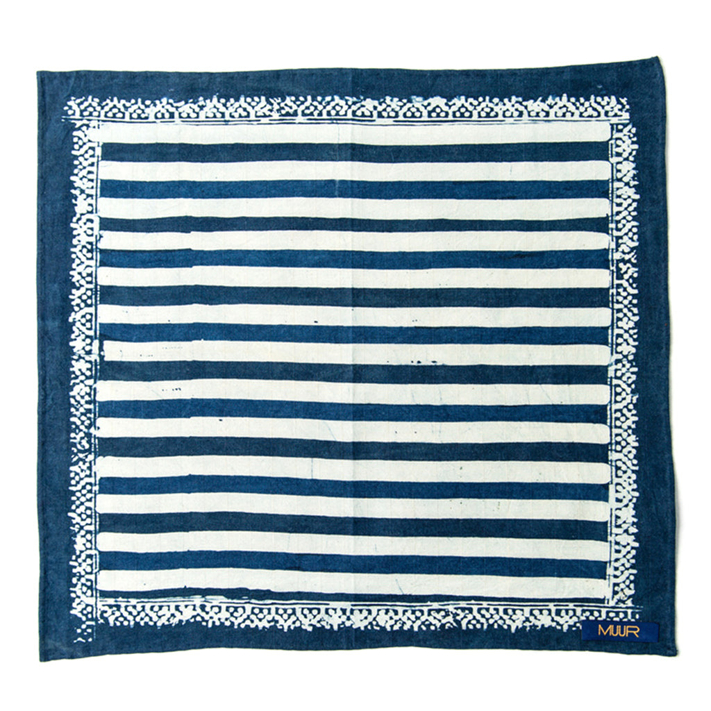 Hand painted indigo dyed pocket square in stripes of indigo and white with solid indigo edge