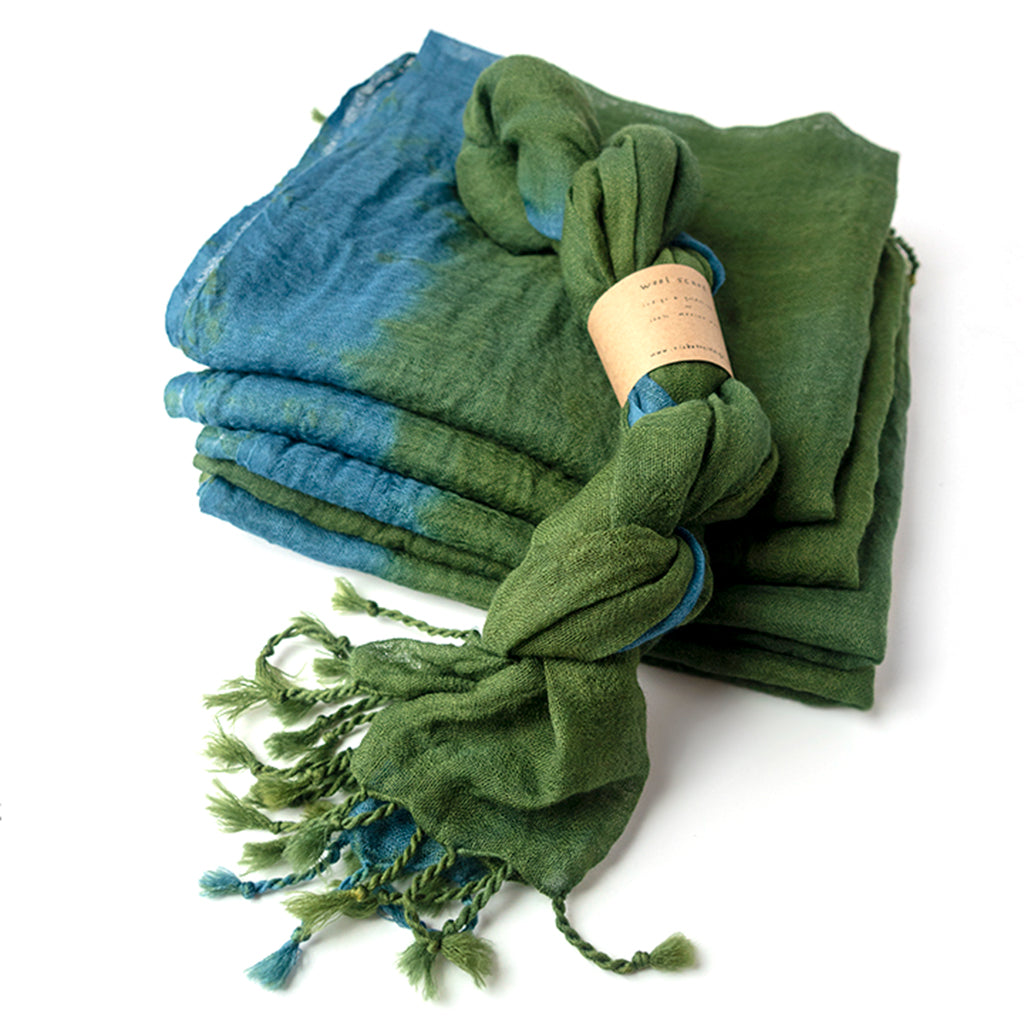 Indigo & Goldenrod Wool Scarf by Ricketts Indigo. 100% wool scarf dyed in green and blues with tasseled edges.