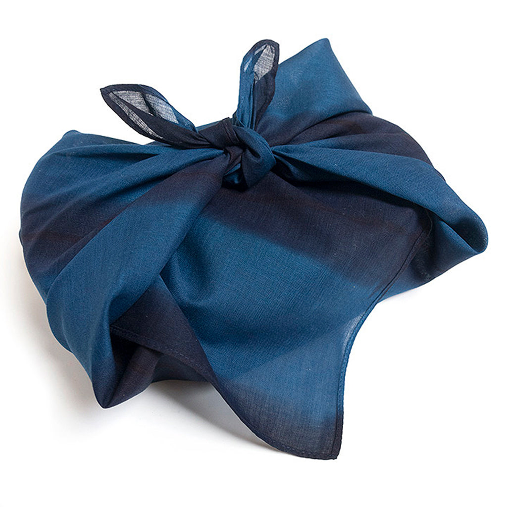 Indigo Dyed Striped Handkerchief by Ricketts shows tied wrapping an object