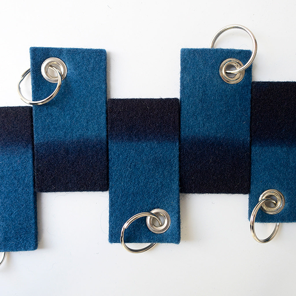 Group of Indigo Dyed Rectangle Felt Keychain with stud and silver chain by Ricketts