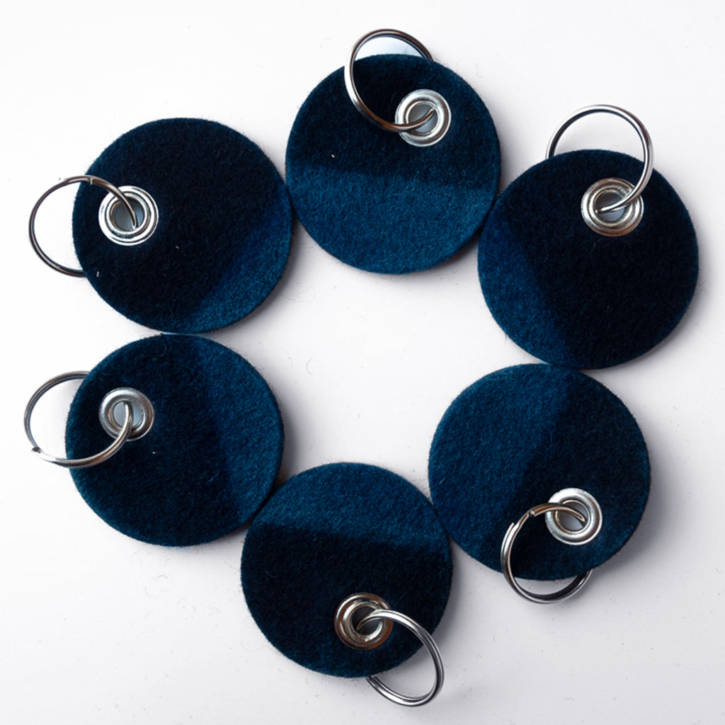 group of Indigo Dyed round Felt Keychain with stud and silver chain by Ricketts
