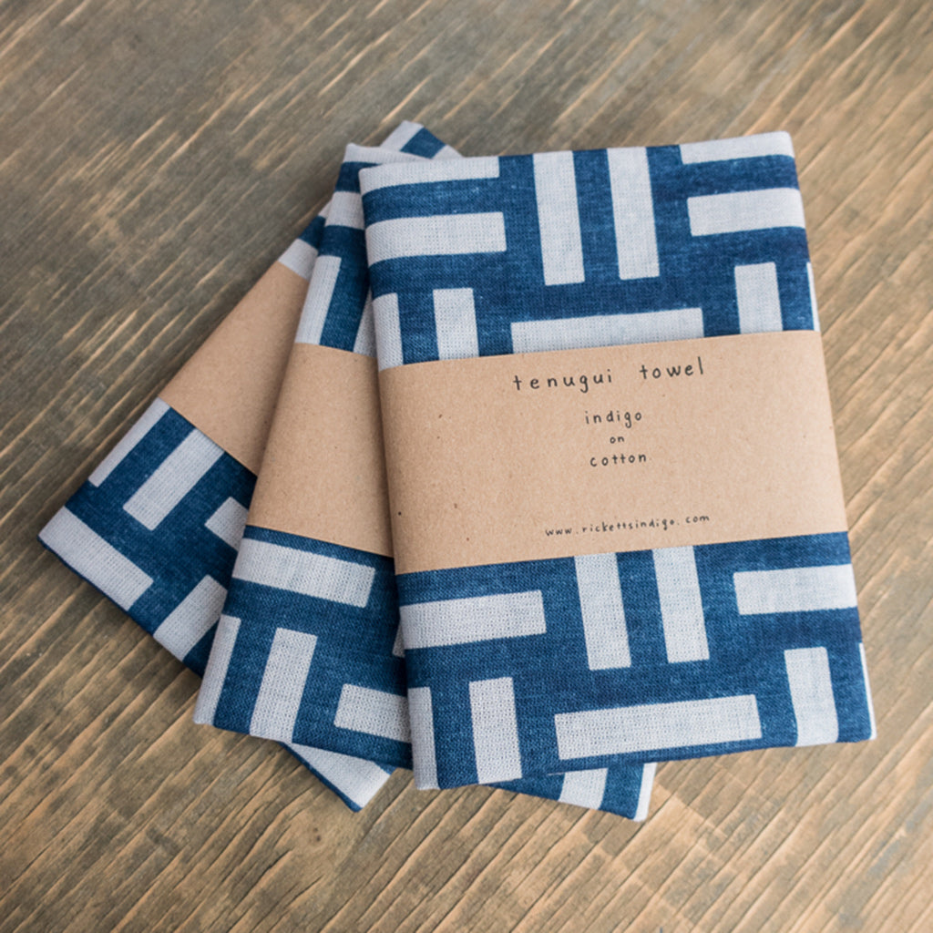three folded Indigo Dyed Basket Weave Pattern Tenugui Towel by Ricketts.