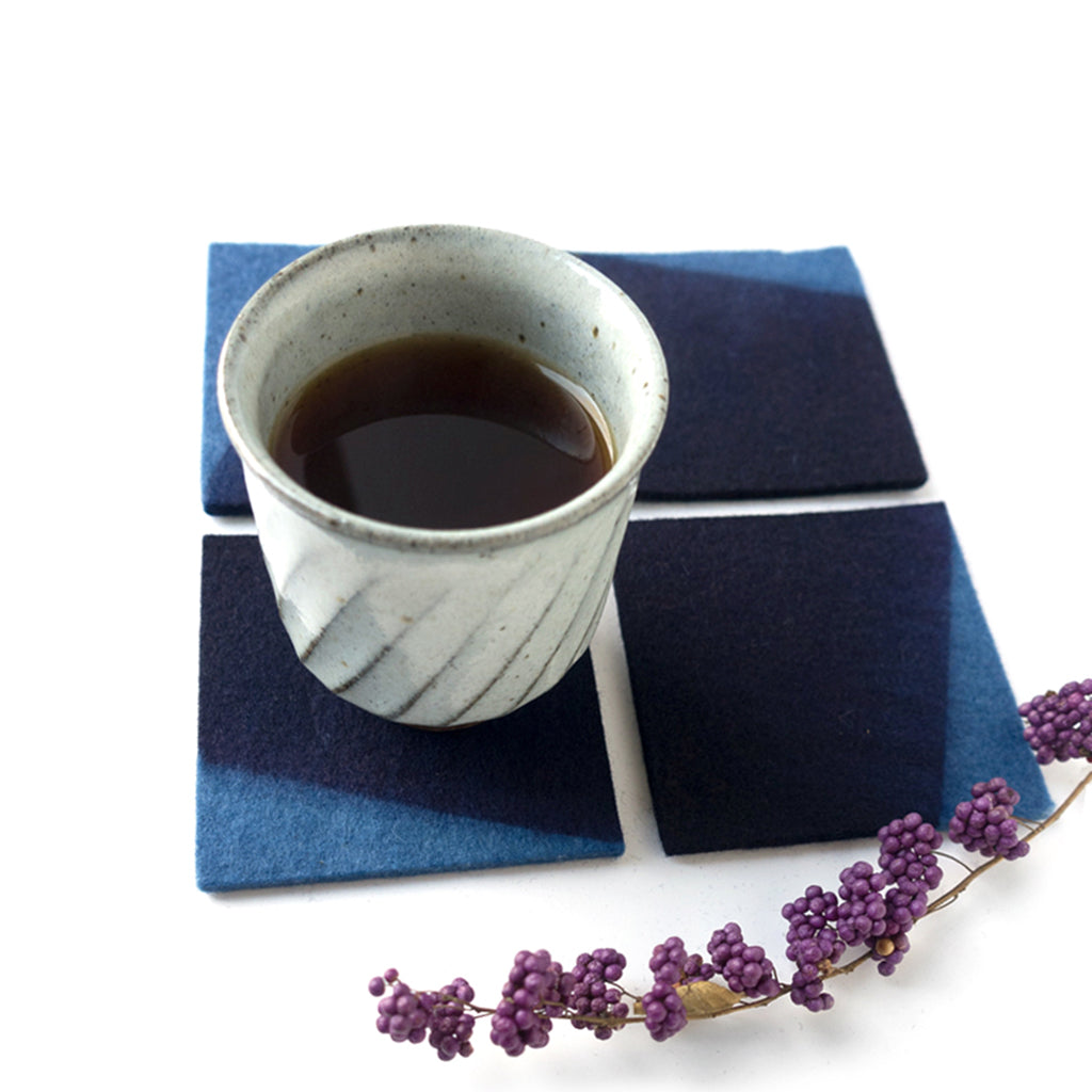 Indigo Dyed Wool Felt Coaster Set of 4 by Ricketts shown with coffee mug
