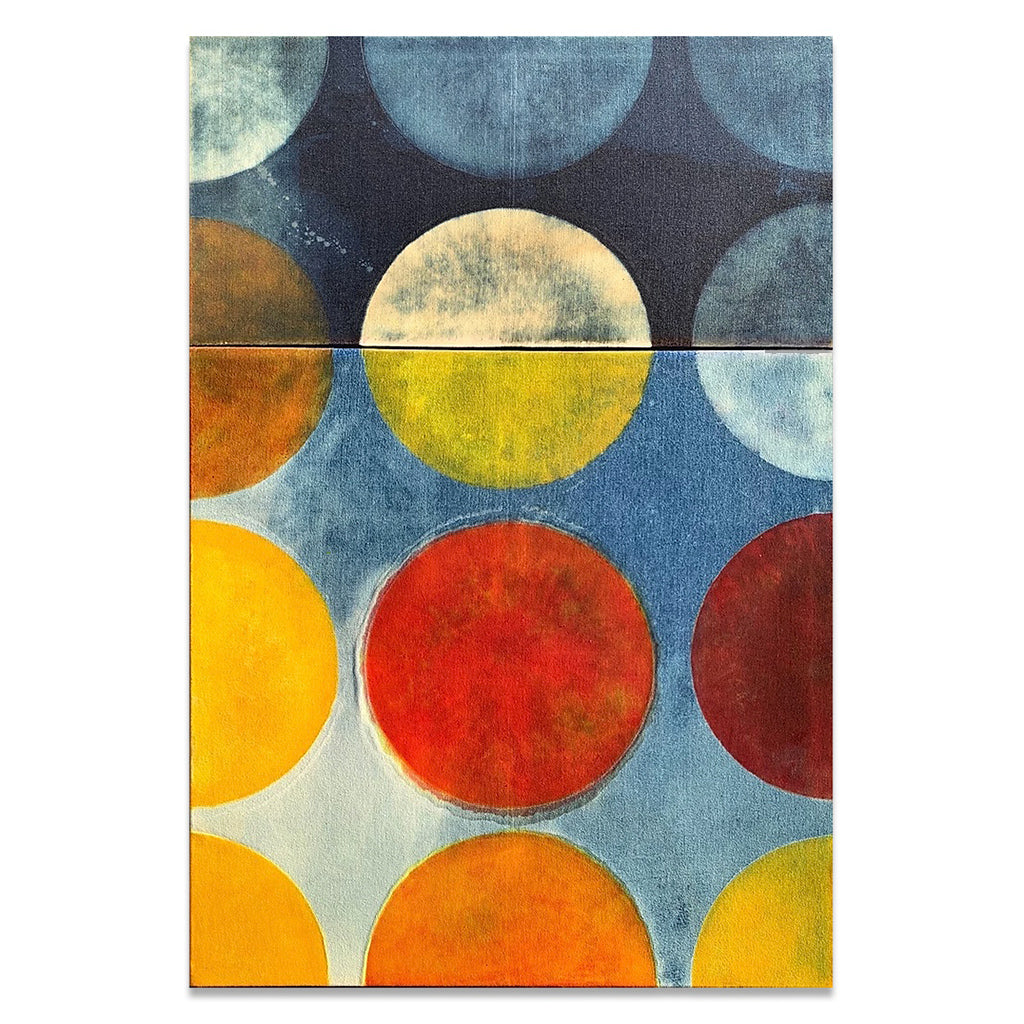 Mixed media painting on recycled denim showing various circles in shades or orange and yellow on a ombre blue background