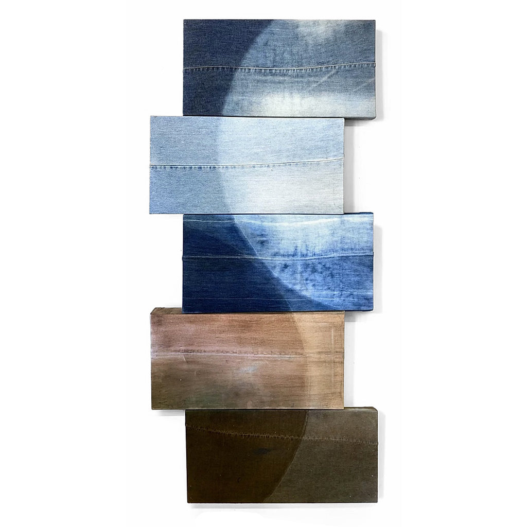 Mixed media painting on recycled denim with five rectangular shapes stacked at various angles in differing colors of brown and blue.