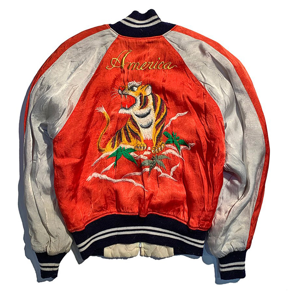 "Vintage 1970's ""America"" Sukajan Souvenir Jacket. Red rody with grey sleeves and tiger logo on each breast pocket. Reverse has large tiger with 'America' embroidered in gold italics above"