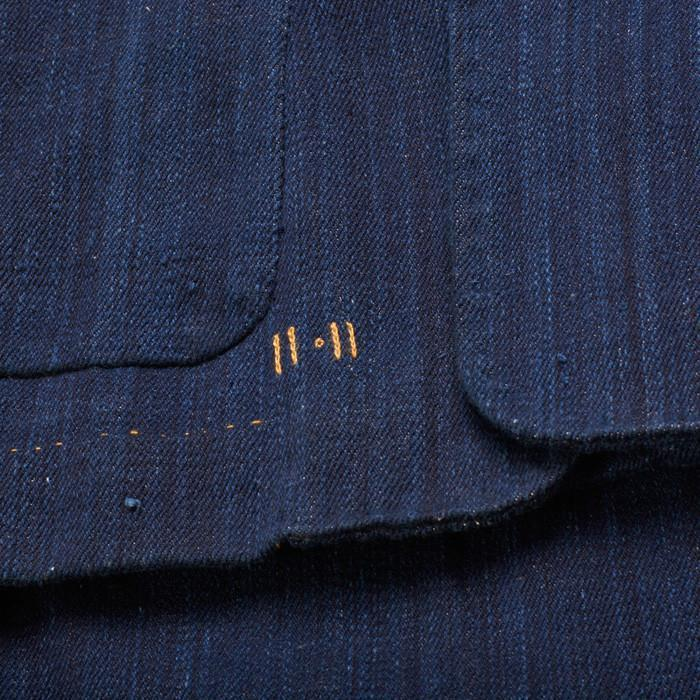 11.11 branding in tan stitching on women's denim jacket