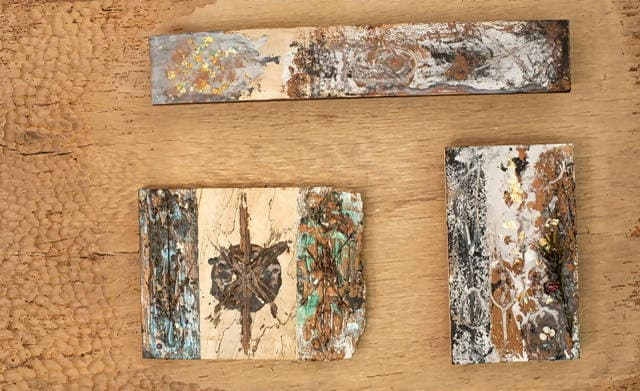 Wall art with encaustic painting on barn threshing wood