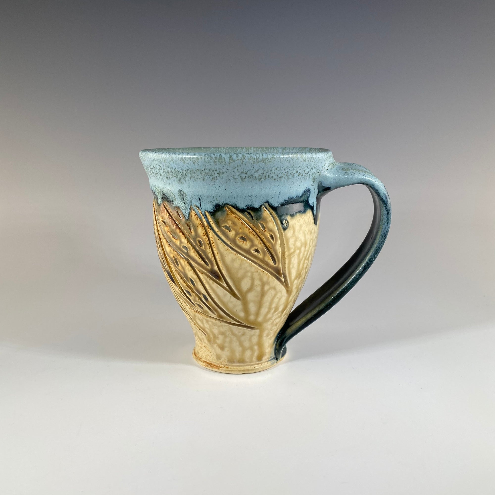 Carved Mug in Teal and Tan with Leaves - Heart of the Home PA