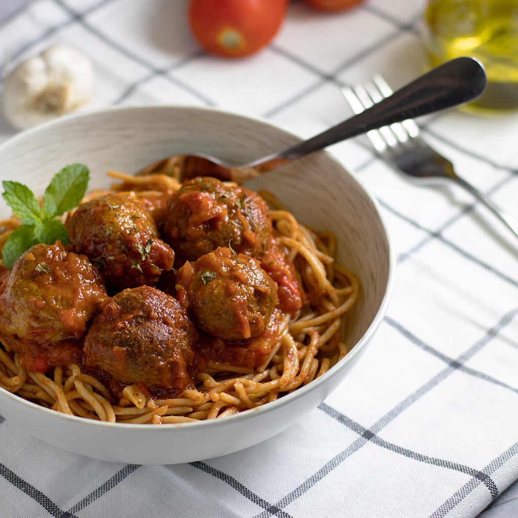 Vegan spaghetti and meatballs in red sauce