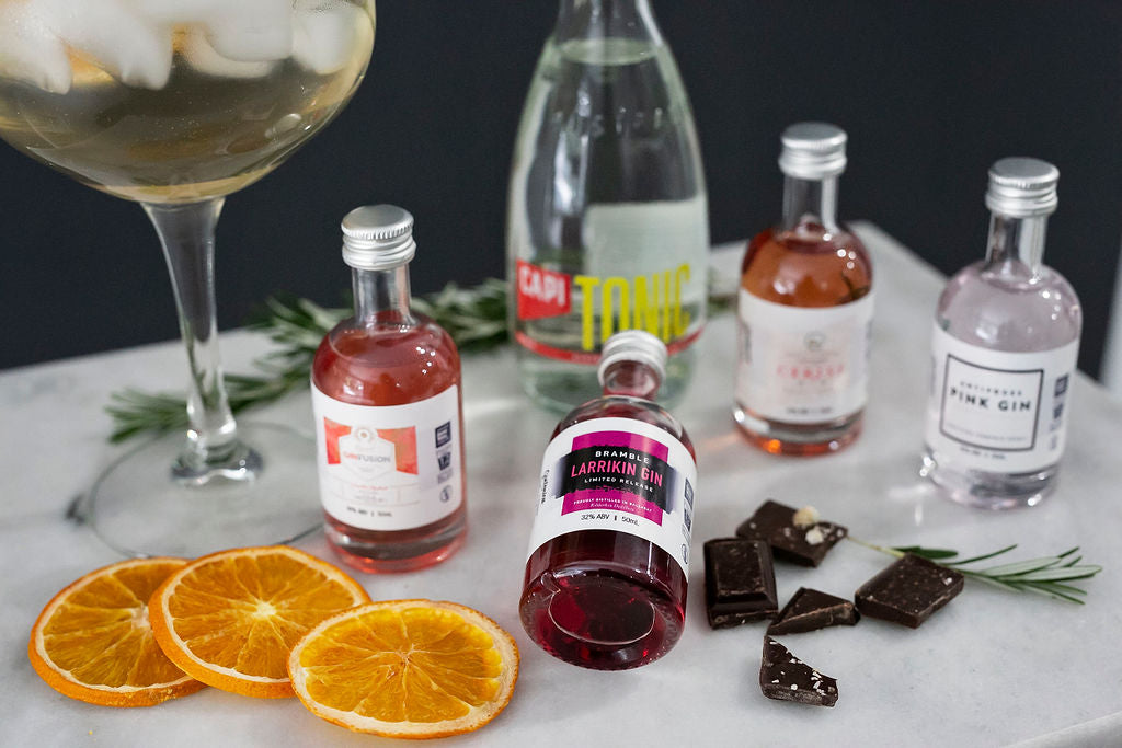 gintonica pink gin and capi tonic cocktail kit with dehydrated fruit and gourmet chocolate