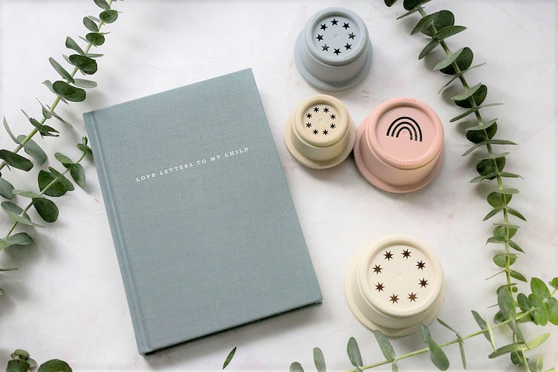 newborn or expectant mum gift box of baby keepsake journal and retro earthy coloured stacking cups