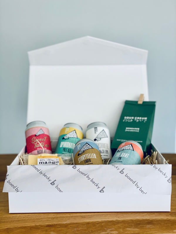 gift box including five beer cans mango chocolate and wondaree macadamias