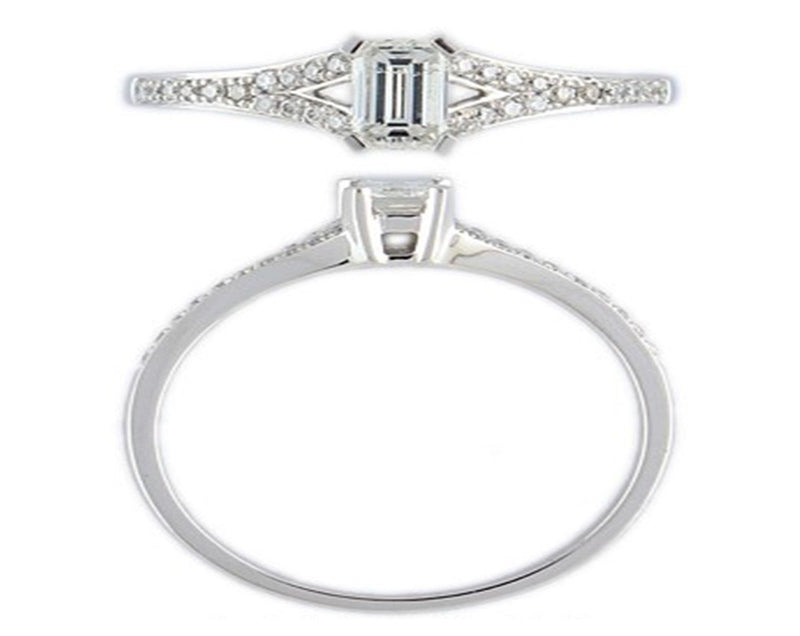 18ct white gold engagement ring set with a centre baguette and halo of diamonds around also diamonds set small down the sides.