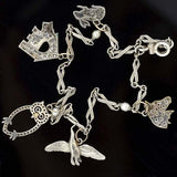 Art Deco Platinum Diamond Emerald Multi Charm Bracelet